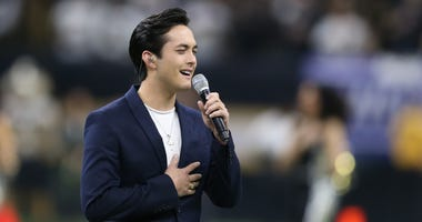 2019 American Idol winner Laine Hardy sings the national anthem before a NFC Wild Card playoff football game between the New Orleans Saints and the Minnesota Vikings at the Mercedes-Benz Superdome.