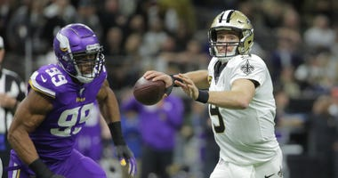 New Orleans Saints quarterback Drew Brees (9) throws a pass against Minnesota Vikings defensive end Danielle Hunter (99) during the first quarter of a NFC Wild Card playoff football game at the Mercedes-Benz Superdome.