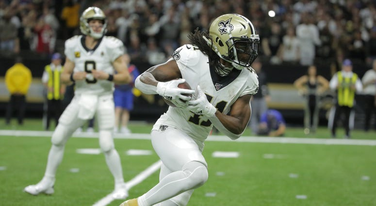 New Orleans Saints running back Alvin Kamara (41) runs the ball for a touchdown against the Minnesota Vikings during the second quarter of a NFC Wild Card playoff football game at the Mercedes-Benz Superdome.