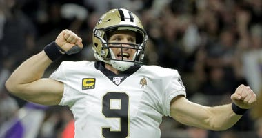 New Orleans Saints quarterback Drew Brees (9) reacts after a Saints touchdown against the Minnesota Vikings during the second quarter of a NFC Wild Card playoff football game at the Mercedes-Benz Superdome.