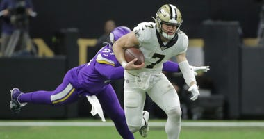 New Orleans Saints quarterback Taysom Hill (7) runs the ball against the Minnesota Vikings during the second quarter of a NFC Wild Card playoff football game at the Mercedes-Benz Superdome.