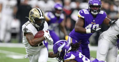 New Orleans Saints wide receiver Deonte Harris (11) runs the ball against Minnesota Vikings defensive back Holton Hill (24) during the third quarter of a NFC Wild Card playoff football game at the Mercedes-Benz Superdome.