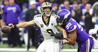 New Orleans Saints quarterback Drew Brees (9) fumbles the ball as he is hit by Minnesota Vikings defensive end Danielle Hunter (99) during the fourth quarter of a NFC Wild Card playoff football game at the Mercedes-Benz Superdome.