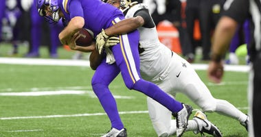 New Orleans Saints defensive end Cameron Jordan (94) sacks Minnesota Vikings quarterback Kirk Cousins (8) during the fourth quarter of a NFC Wild Card playoff football game at the Mercedes-Benz Superdome.