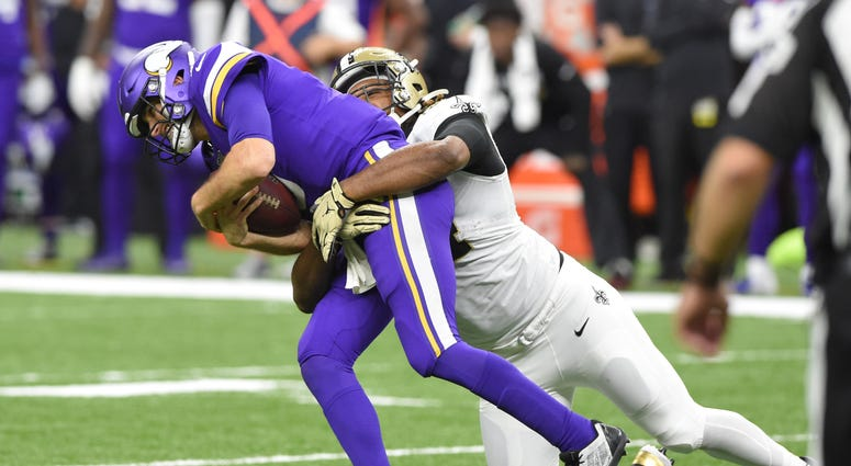 New Orleans Saints defensive end Cameron Jordan (94) sacks Minnesota Vikings quarterback Kirk Cousins (8) during the fourth quarter of a NFC Wild Card playoff football game at the Mercedes-Benz Superdome.
