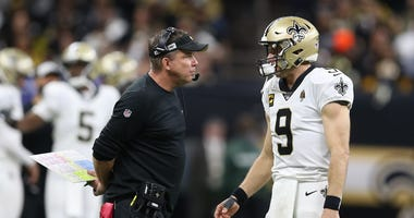New Orleans Saints quarterback Drew Brees (9) talks with head coach Sean Payton during the fourth quarter of a NFC Wild Card playoff football game against the Minnesota Vikings at the Mercedes-Benz Superdome.