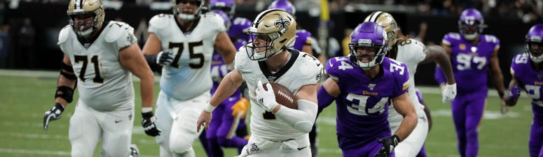 New Orleans Saints player Taysom Hill (7) against past Minnesota Vikings strong safety Andrew Sendejo (34) during the fourth quarter of a NFC Wild Card playoff football game at the Mercedes-Benz Superdome.