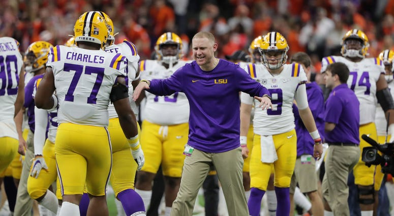 LSU Tigers passing game coordinator Joe Brady talks to his team before the College Football Playoff national championship game against the Clemson Tigers at Mercedes-Benz Superdome.