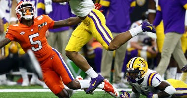 LSU Tigers safety Grant Delpit (7) attempts to make an interception during the first quarter against the Clemson Tigers in the College Football Playoff national championship game at Mercedes-Benz Superdome.