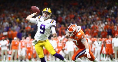 LSU Tigers quarterback Joe Burrow (9) throws a pass against the Clemson Tigers in the College Football Playoff national championship game at Mercedes-Benz Superdome.