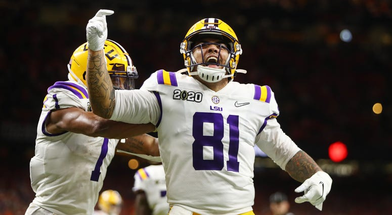LSU Tigers tight end Thaddeus Moss (81) celebrates after scoring a touchdown against the Clemson Tigers in the third quarter in the College Football Playoff national championship game at Mercedes-Benz Superdome.