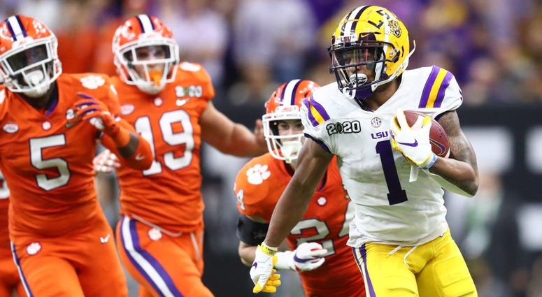 LSU Tigers wide receiver Ja'Marr Chase (1) runs with the ball against the Clemson Tigers in the fourth quarter in the College Football Playoff national championship game at Mercedes-Benz Superdome.