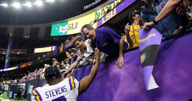 LSU Tigers safety JaCoby Stevens (3) celebrates with fans after the LSU Tigers defeated the Clemson Tigers in the College Football Playoff national championship game at Mercedes-Benz Superdome.