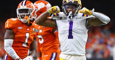 LSU Tigers wide receiver Ja'Marr Chase (1) celebrates a play against the Clemson Tigers in the College Football Playoff national championship game at Mercedes-Benz Superdome.