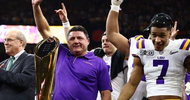 New Orleans, Louisiana, USA; LSU Tigers head coach Ed Orgeron celebrates after a victory against the Clemson Tigers in the College Football Playoff national championship game at Mercedes-Benz Superdome.