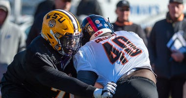 South offensive lineman Lloyd Cushenberry III of LSU (79) spars with South defensive tackle Josiah Coatney of Ole Miss (40) during Senior Bowl practice.
