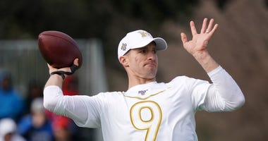 New Orleans Saints quarterback Drew Brees throws the ball during NFC practice at ESPN Wide World of Sports.