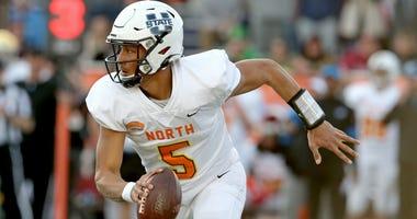 North quarterback Jordan Love of Utah State (5) runs from pressure in the second half of the 2020 Senior Bowl college football game at Ladd-Peebles Stadium.