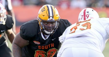 South offensive lineman Damien Lewis of LSU (68) in the second half of the 2020 Senior Bowl college football game at Ladd-Peebles Stadium.
