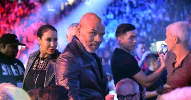 Boxing Hall of Fame member Mike Tyson attends the WBC heavyweight title bout between Deontay Wilder and Tyson Fury at MGM Grand Garden Arena.
