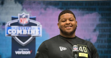 Michigan offensive lineman Cesar Ruiz (OL40) speaks to the media during the 2020 NFL Combine in the Indianapolis Convention Center.
