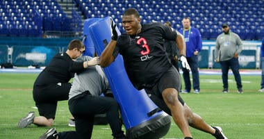 uburn Tigers defensive lineman Derrick Brown (DL03) goes through a workout drill during the 2020 NFL Combine at Lucas Oil Stadium.