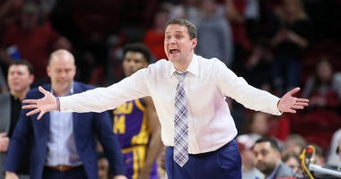 LSU Tigers head coach Will Wade reacts to a play in the game against the Arkansas Razorbacks at Bud Walton Arena. Arkansas won 99-90.