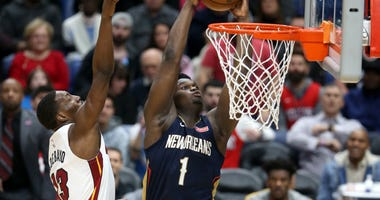 New Orleans Pelicans forward Zion Williamson (1) dunks against Miami Heat forward Bam Adebayo (13) in the second half at the Smoothie King Center.