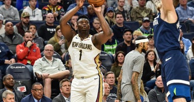 New Orleans Pelicans forward Zion Williamson (1) shoots the ball as Minnesota Timberwolves guard Jaylen Nowell (4) defends during the second quarter at Target Center.