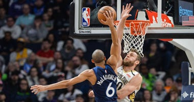 Minnesota Timberwolves guard Jordan McLaughlin (6) goes to the basket as New Orleans Pelicans forward Nicolo Melli (20) defends during the second quarter at Target Center.