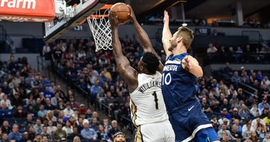 New Orleans Pelicans forward Zion Williamson (1) goes to the basket as Minnesota Timberwolves guard Jacob Evans (10) defends during the second quarter at Target Center.
