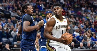 New Orleans Pelicans forward Zion Williamson (1) and Minnesota Timberwolves center Naz Reid (11) in action at Target Center.