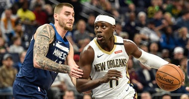 New Orleans Pelicans guard Jrue Holiday (11) and Minnesota Timberwolves forward Juan Hernangomez (41) in action at Target Center.