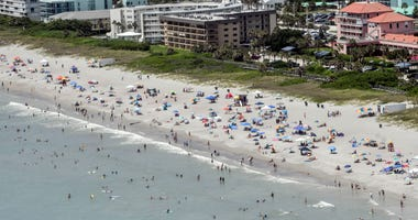 Beachgoers enjoy the sun and sand eat Shepard Park in Cocoa Beach Saturday afternoon, June 27, 2020.