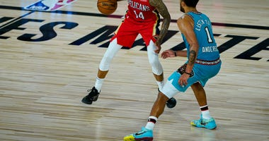 New Orleans Pelicans' Brandon Ingram (14) drives on Memphis Grizzlies' Kyle Anderson (1) during the second half of an NBA basketball game Monday, Aug. 3, 2020 in Lake Buena Vista, Fla.