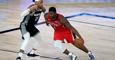 New Orleans Pelicans' Zion Williamson (1) moves to the basket against Sacramento Kings' Richaun Holmes (22) during the second half of an NBA basketball game at HP Field House.