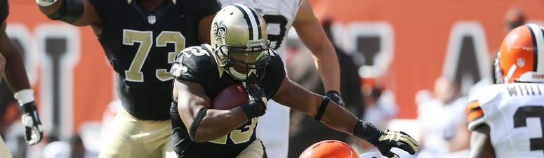 New Orleans Saints running back Pierre Thomas (23) looks for running room against the Cleveland Browns during the fourth quarter at FirstEnergy Stadium. The Browns won 26-24.