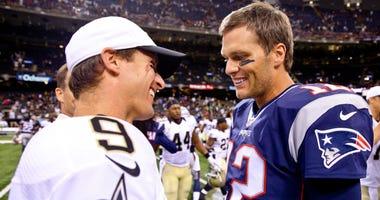 Aug 22, 2015; New Orleans, LA, USA; New England Patriots quarterback Tom Brady (12) talks to New Orleans Saints quarterback Drew Brees (9) following a preseason game at the Mercedes-Benz Superdome. The Patriots defeated the Saints 26-24.