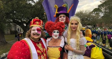 Bobby Hebert and Mike Detillier in the Magical Krewe of Mad Hatters parade.
