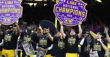 LSU Tigers players celebrate after defeating the Clemson Tigers in the College Football Playoff national championship game at Mercedes-Benz Superdome.