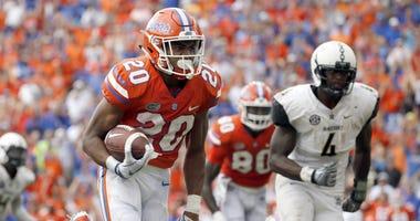 Sep 30, 2017; Gainesville, FL, USA; Florida Gators running back Malik Davis (20) runs the ball in for a touchdown against the Vanderbilt Commodores during the second half at Ben Hill Griffin Stadium.