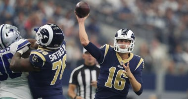 Los Angeles Rams quarterback Jared Goff (16) throws in the pocket in the second quarter against the Dallas Cowboys at AT&T Stadium.