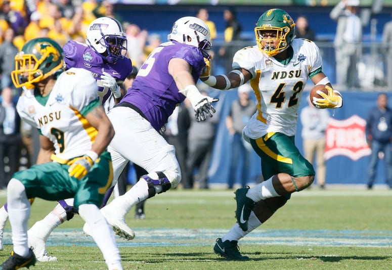 North Dakota State Bison linebacker Jabril Cox (42) is tackled by James Madison Dukes offensive lineman Nick Edwards (55) after picking up a fumble in the second quarter at Toyota Stadium.