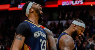 Jan 26, 2018; New Orleans, LA, USA; New Orleans Pelicans forward Anthony Davis (23) and center DeMarcus Cousins (0) react after a basket during the fourth quarter against the Houston Rockets at the Smoothie King Center. Pelicans defeated the Rockets 115-1