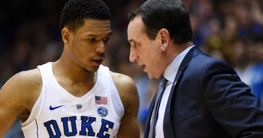Feb 24, 2018; Durham, NC, USA; Duke Blue Devils head coach Mike Krzyzewski (right) talks to Duke Blue Devils guard Trevon Duval (1) during the second half against the Syracuse Orange at Cameron Indoor Stadium. Duke won 60-44.