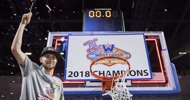 March 6, 2018; Las Vegas, NV, USA; Gonzaga Bulldogs forward Killian Tillie (33) celebrates after cutting the net against the BYU Cougars after the championship game of the West Coast Conference tournament at Orleans Arena.