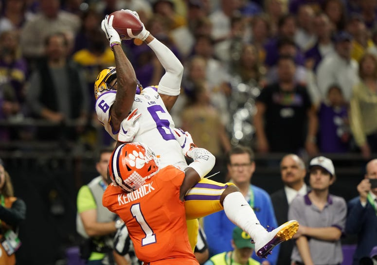 LSU Tigers wide receiver Terrace Marshall Jr. (6) makes a catch for a touchdown against Clemson Tigers cornerback Derion Kendrick (1) in the fourth quarter in the College Football Playoff national championship game at Mercedes-Benz Superdome.
