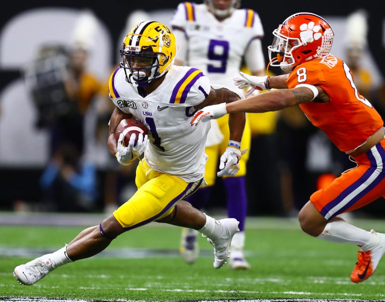 Clemson Tigers receiver Ja'Marr Chase (1) runs after a reception against the LSU Tigers in the College Football Playoff national championship game at Mercedes-Benz Superdome.