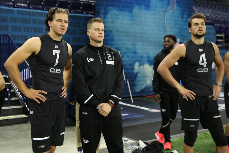 Oregon Ducks quarterback Justin Herbert (QB07) and Louisiana State Tigers quarterback Joe Burrow (QB02) watch from the sidelines during the 2020 NFL Combine at Lucas Oil Stadium.