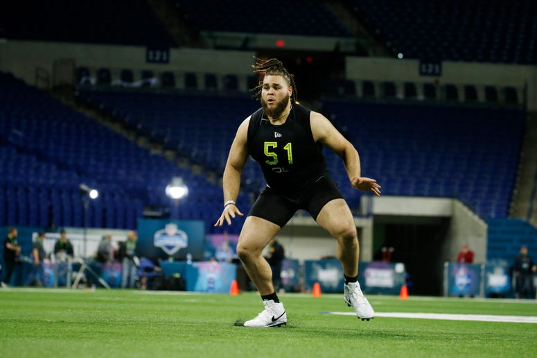 Alabama Crimson Tide offensive lineman Jedrick Wills (OL51) goes through a workout drill during the 2020 NFL Combine at Lucas Oil Stadium.
